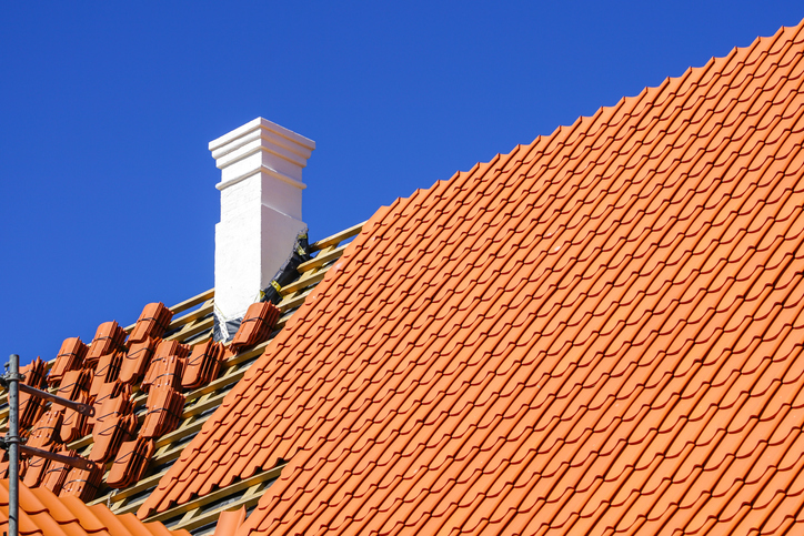 restoration of a historic wooden house, chimney repair and replacement of roof clay tiles