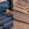 side by side photo of metal roofing and asphalt roof.