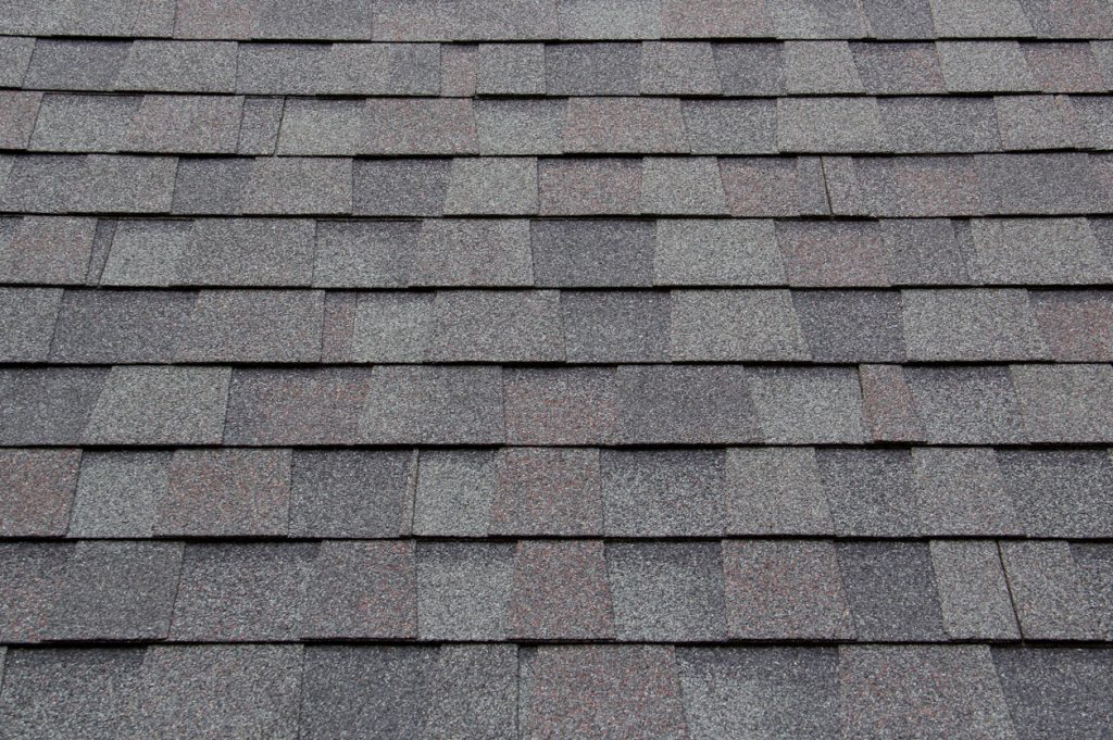 Asphalt shingles properly laid out on roof.