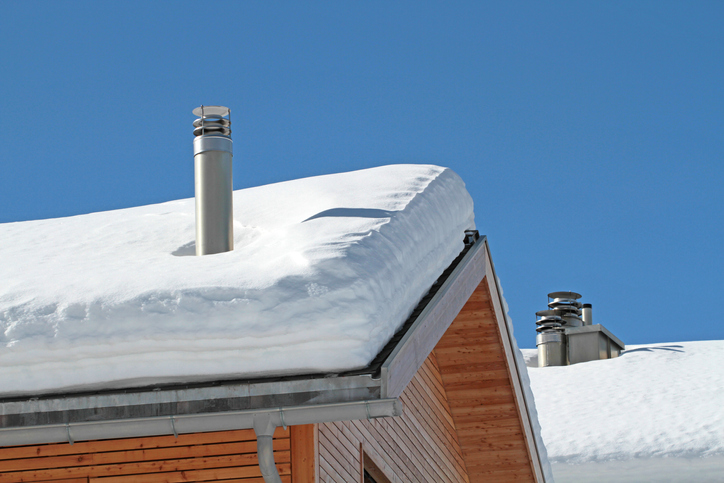 tailpipes on snowy roofs