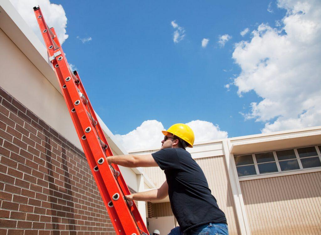 man using ladder