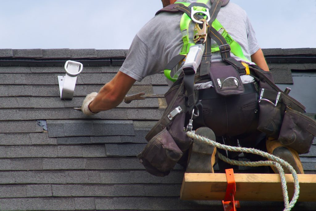 man wearing safety gear on roof